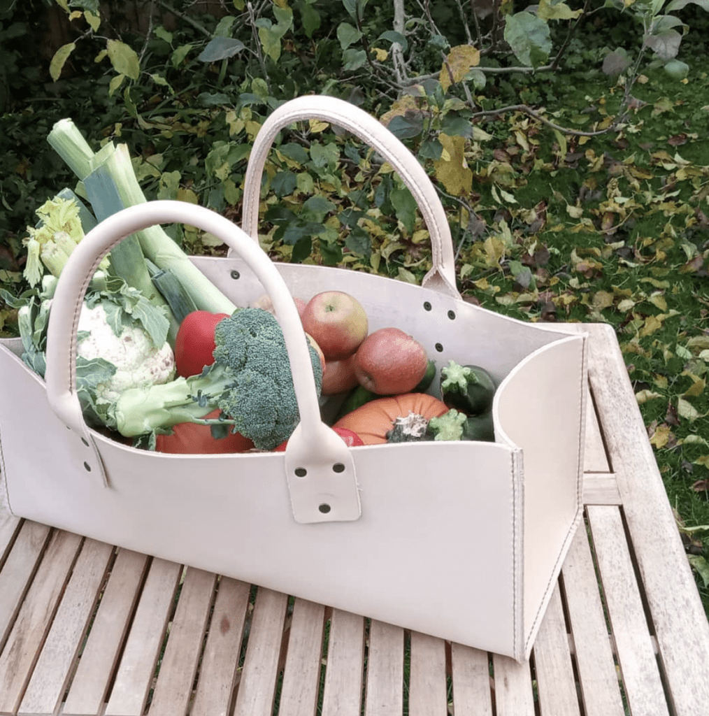 handmade leather trug in cream with fruit and veg inside