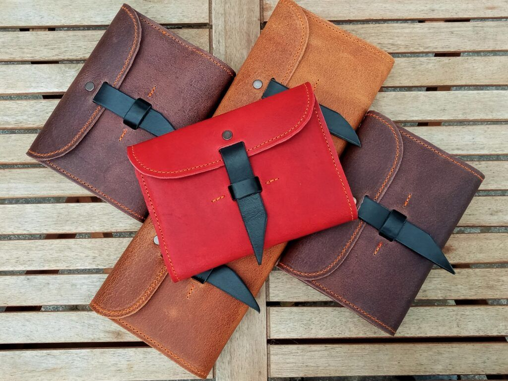 5 handmade leather notebooks in browns and red